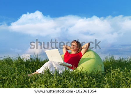 Sit back and relax - woman resting outdoors in the sun - stock photo
