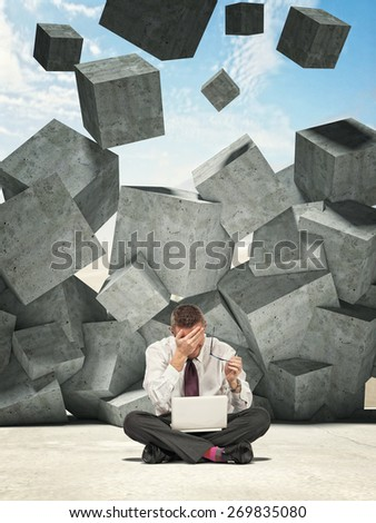 sit businessman and falling concrete cubes - stock photo