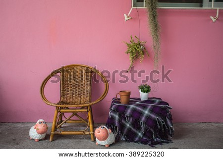 sit down and sip aromatic coffee on rattan chair in the relaxing morning ,wicker chair,cane chair - stock photo