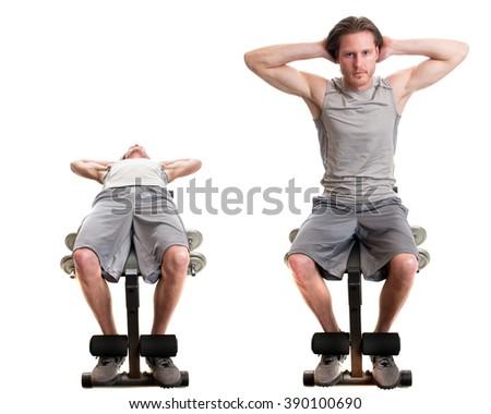 Sit up exercise. Studio shot over white. - stock photo