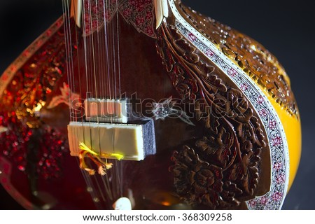 Sitar, a String Traditional Indian Musical Instrument, close-up, blue lens effect. dark background, soft focus. Evening of ethnic oriental music. Indian Raga - stock photo