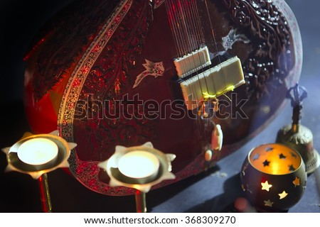 Sitar, a String Traditional Indian Musical Instrument, close-up, blue lens effect. dark background with incense smoke. Evening of ethnic oriental music. Indian Raga - stock photo