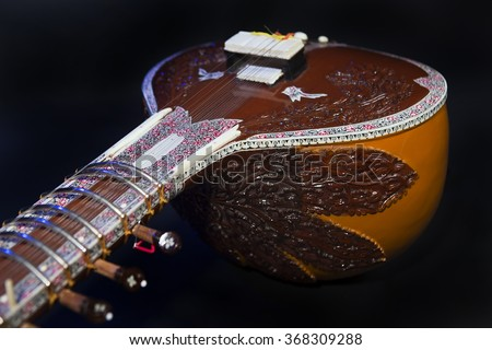 Sitar, a String Traditional Indian Musical Instrument, close-up, blue lens effect. dark background. Evening of ethnic oriental music. Indian Raga - stock photo