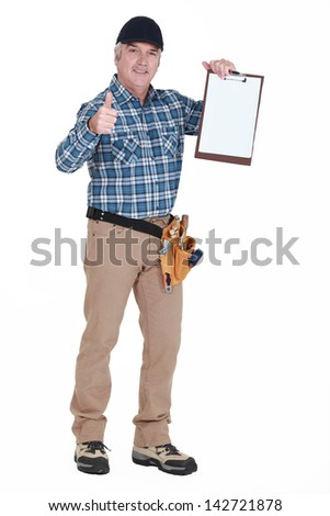 Site inspector giving the thumbs-up - stock photo