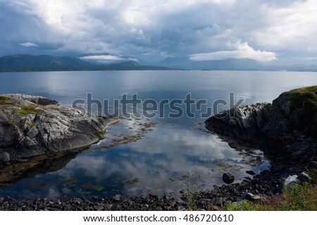 Site of a coastline of an ocean gulf before a bad weather, Norway, the Atlantic road