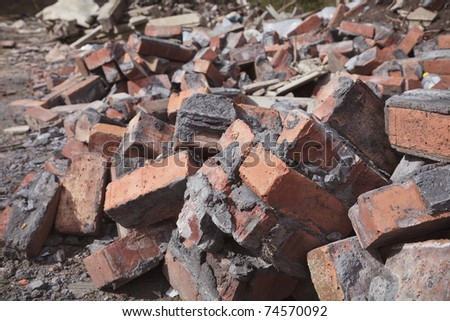 site of a demolished building showing bricks and rubble