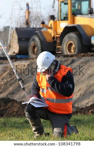 Site surveyor taking readings - stock photo