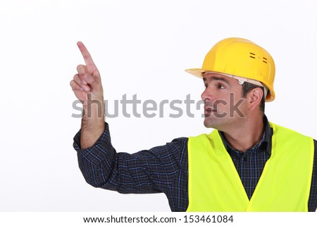 Site worker pointing - stock photo