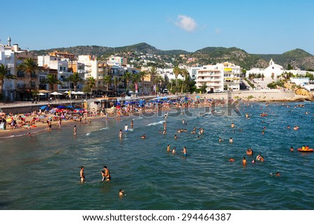 SITGES, SPAIN - AUGUST 6: Sitges beach in August 6, 2013 in Sitges, Spain. 