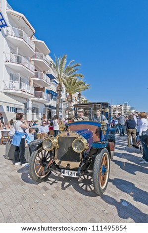 "SITGES, SPAIN - MARCH 11: Jaume Vidal Aroza drives a 1911 Mors on the second phase of the ""54th Rally of Ancient Cars Barcelona-Sitges"" on March 11, 2012 in Sitges, Spain."