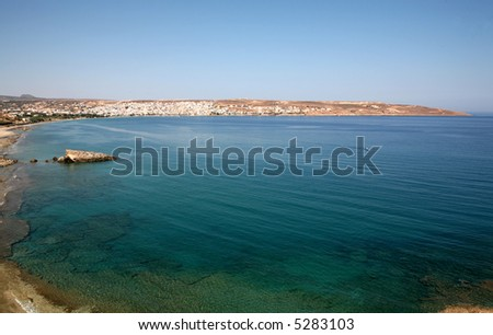 Sitia, the Cretan provincial capitial of Lasithi, seen across turquoise waters of Sitia Bay.