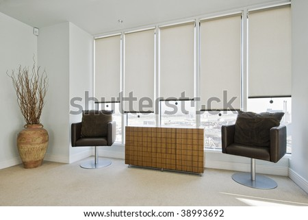sitting area in a contemporary bedroom of a duplex apartment - stock photo