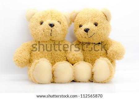 sitting bear toy isolated on white - stock photo