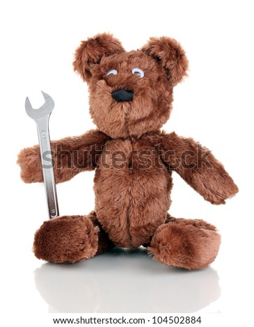 Sitting bear toy with wrench isolated on white
