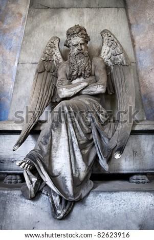 sitting bearded angel - stock photo