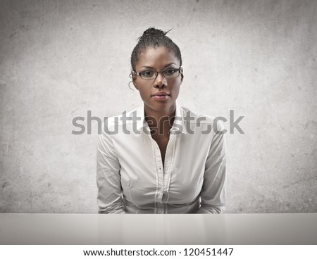 Sitting black girl in white shirt with glasses