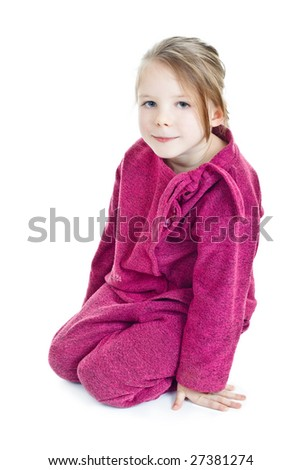 Sitting blonde little girl in purple