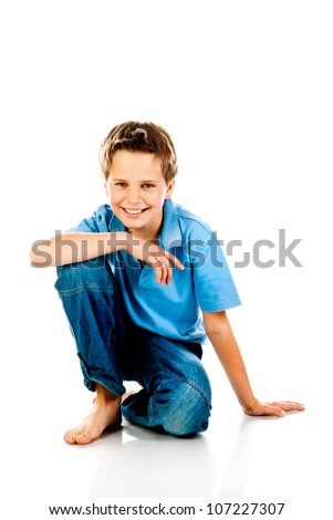 sitting boy isolated on a white background