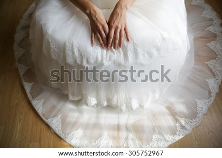 sitting bride with her hands