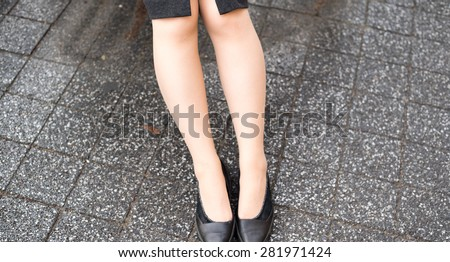 Sitting business woman's legs