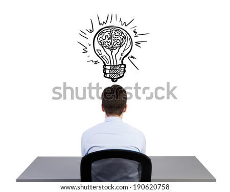 Sitting businessman and lightbulb - stock photo