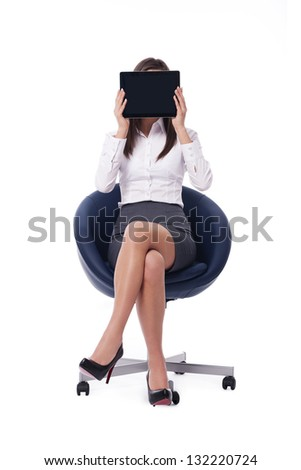 Sitting businesswoman holding digital tablet - stock photo