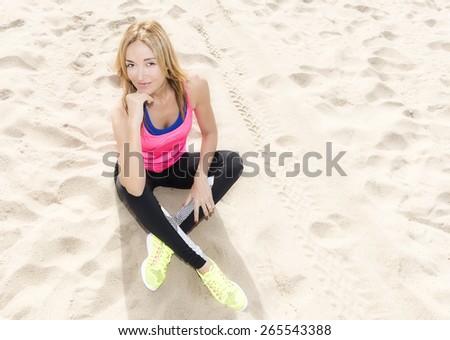 Sitting on the beach - stock photo