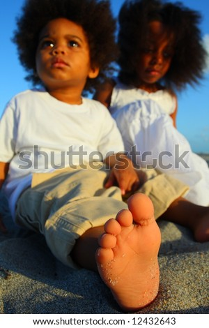 Sitting on the sand with focus on the foreground - stock photo