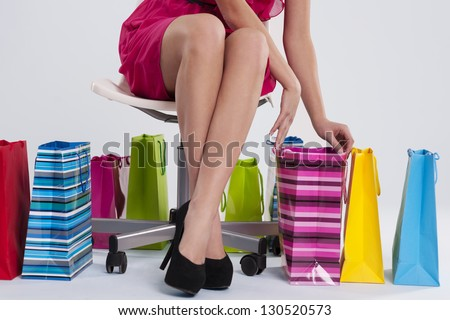 Sitting woman checks her shopping