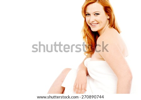 Sitting woman wrapped towel for bath - stock photo