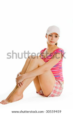 sitting young woman in summer clothes on white