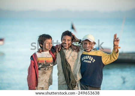 Sittwe, MYANMAR - DEC 11, 2014: Unidentified Burmese boy group smile in Sittwe on December 11, 2014 in Sittwe, Myanmar. - stock photo