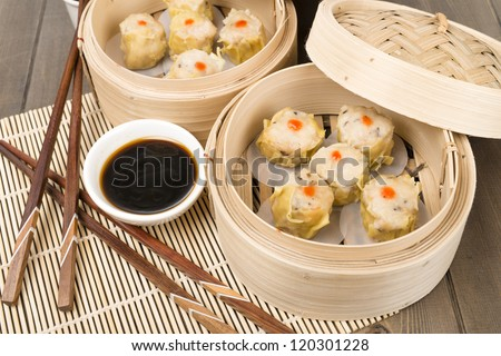 Siu Mai - Chinese steamed pork dumplings in bamboo steamers. Dim Sum - stock photo