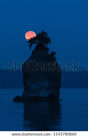 Siwash Rock with full moon background