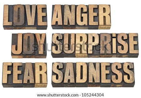 six basic emotions - love, fear, joy, anger, surprise and sadness - a collage of isolated words in vintage letterpress wood type - stock photo