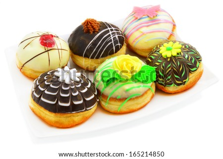 Six beautiful donuts on a white background.