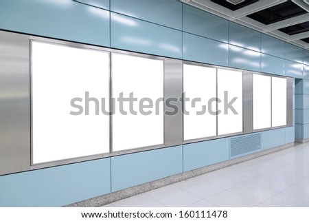 Six big vertical / portrait orientation blank billboard in public transport - stock photo