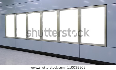 Six big vertical / portrait orientation blank billboard on modern blue wall - stock photo