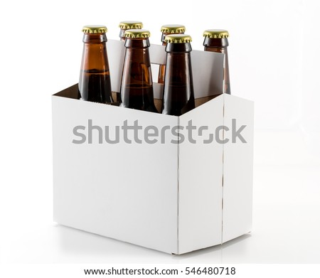 Six bottles of beer in cardboard carrier