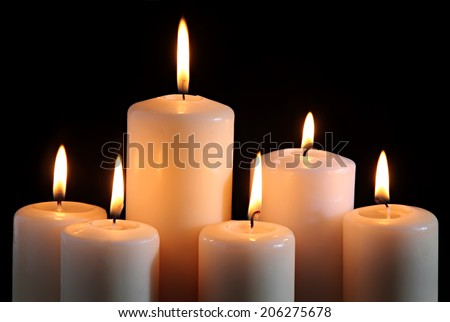 six candles on a black background. - stock photo