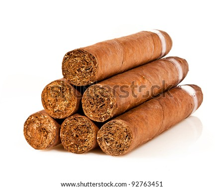 Six cigars on a white background - stock photo