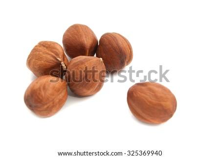 six delicious hazelnuts closeup on white background  - stock photo