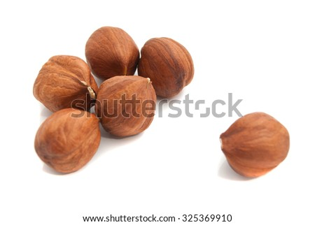 six delicious hazelnuts on white background closeup - stock photo