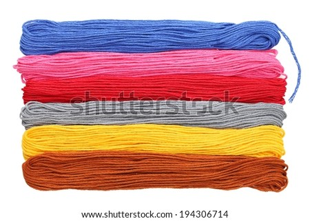 Six different colors of yarn stacked on top of each other. - stock photo