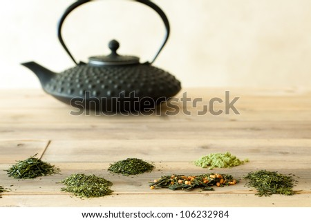 Six different Japanese teas in the form of tea leaves and ground tea - stock photo