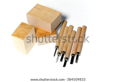 Six different wood carving tools and three blocks of basswood, over white, not isolated
