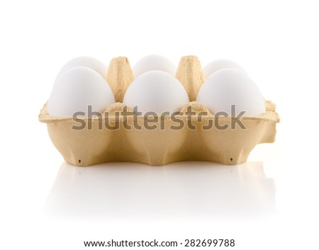 Six Eggs in carton on white with clipping path - stock photo