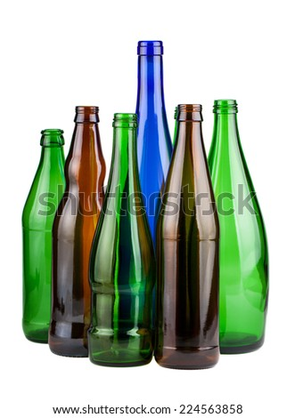 Six empty unlabeled bottles isolated on white background - stock photo