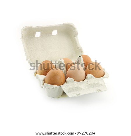 Six fresh range eggs in a corrugated cardboard egg-cup over monochrome white background - stock photo