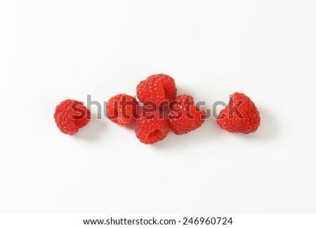 six fresh raspberries - stock photo